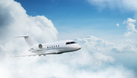 Small private jetplane flying above beautiful clouds. Stok Fotoğraf - 124302930