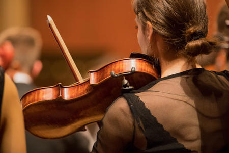 Violinist player during a classical concert music, close-up. Stok Fotoğraf - 124302977