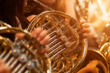 French horn during a classical concert music, close-up. Stock Photo - 124302991
