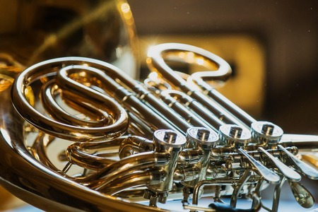 French horn during a classical concert music, close-up.
