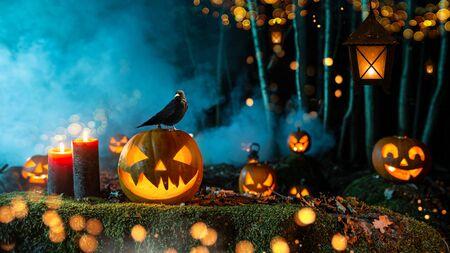 Halloween pumpkins on dark spooky forest. Stock fotó