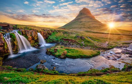 Beautiful landscape with sunrise on Kirkjufellsfoss waterfall and Kirkjufell mountain, Iceland.