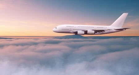Huge two-storey passengers commercial airplane flying above dramatic clouds. Stok Fotoğraf