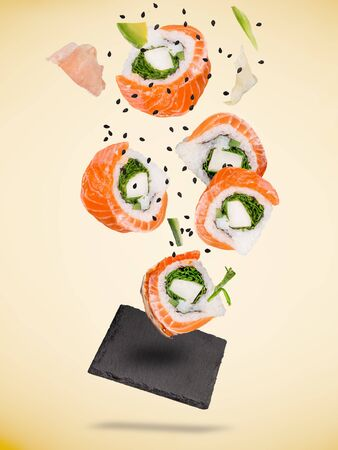 Pieces of delicious japanese sushi frozen in the air. Stok Fotoğraf
