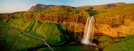 Beautiful Seljalandsfoss waterfall in Iceland during Sunset.