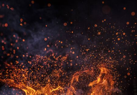 Burning sparks flying. Beautiful flames background. Stok Fotoğraf
