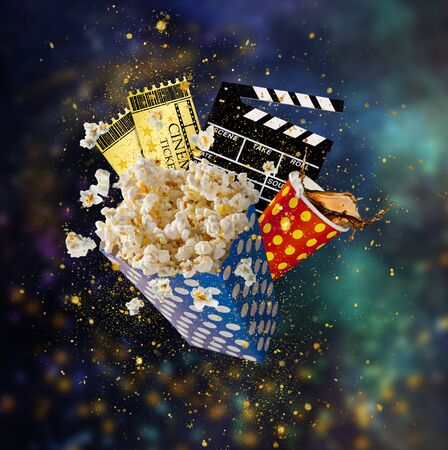 Pop-corn, movie tickets, clapperboard and other things in motion. Zdjęcie Seryjne