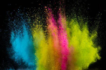 Colored powder explosion on black background. Freeze motion. Zdjęcie Seryjne
