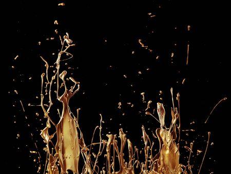 abstract golden liquid splash isolated on black background Zdjęcie Seryjne