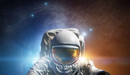 Astronaut at spacewalk. Concept of conquering the universe by the human race.
