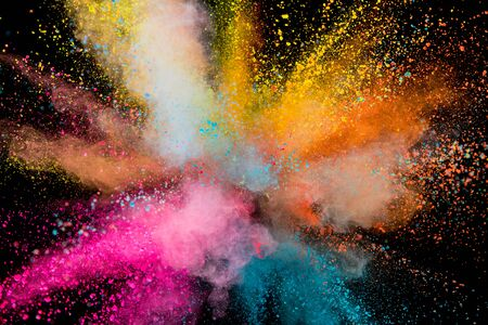 Colored powder explosion on black background. Freeze motion. 스톡 콘텐츠