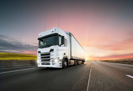 Truck with container on highway, cargo transportation concept. Shaving effect.