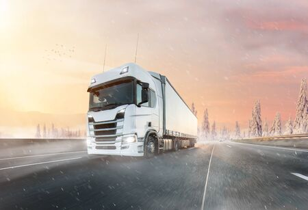 Truck with container on winter highway, cargo transportation concept. Shaving effect.