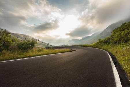 Asphalt road in Dolomites in a summer day.