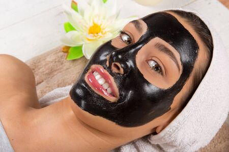 Young healthy woman with black face mask. 写真素材