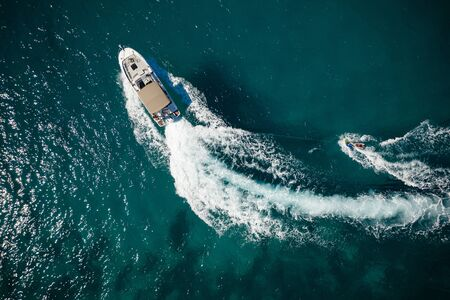 Aerial photo of man practicing wakeboarding