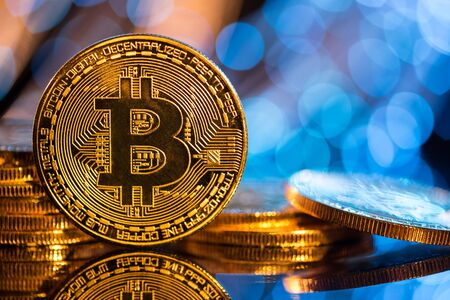 Bitcoin gold coin with defocused abstract