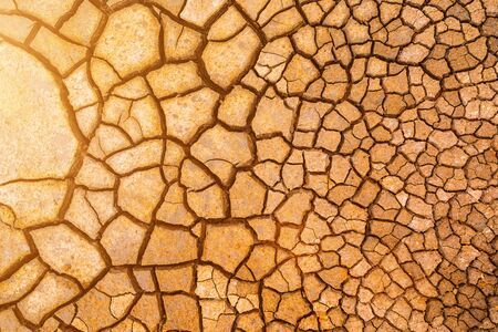 Brown dry cracked ground texture background. Stock Photo