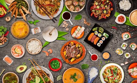 Asian food background with various ingredients on rustic stone background , top view.