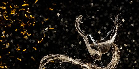 Glasses of champagne levitating in the air, celebration theme. Stock Photo
