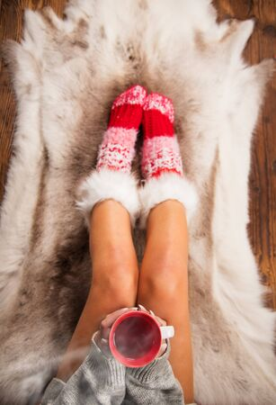 Girl in Christmas socks enjoying a winter time. 版權商用圖片