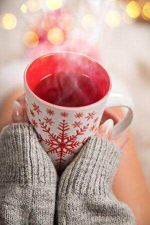 Girl in Christmas socks enjoying a winter time. Stockfoto