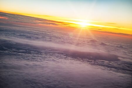 Sunset sky with beautiful clouds from the airplane window Stock Photo - 133561415