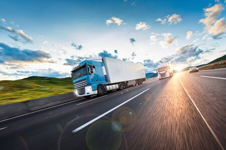 Truck with container on road, cargo transportation concept. Stockfoto