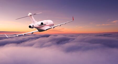 Small private jetplane flying above beautiful clouds. Stock Photo