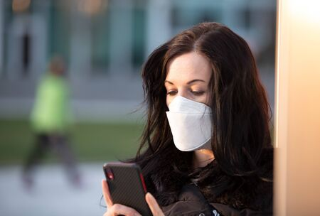 Woman in city with a face mask against infection 免版税图像