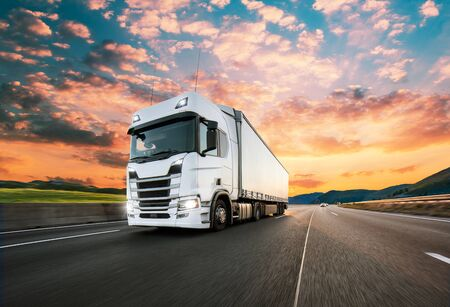 Truck with container on highway, cargo transportation concept. Shaving effect. Standard-Bild - 145914311