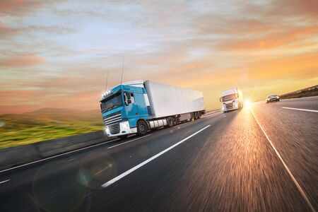 Truck with container on road, cargo transportation concept. Standard-Bild - 145914107
