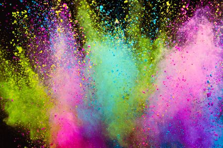 Launched colorful powder on black background Imagens