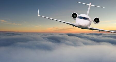 Small private jetplane flying above beautiful clouds.