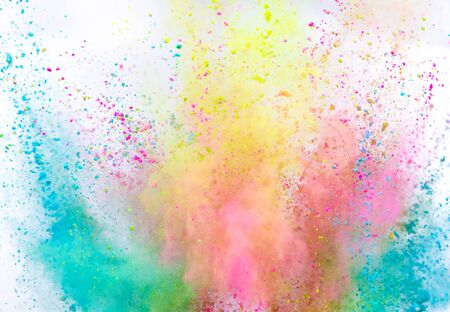 Launched colorful powder on white background Imagens