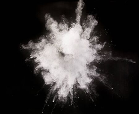 Launched silver powder on black background