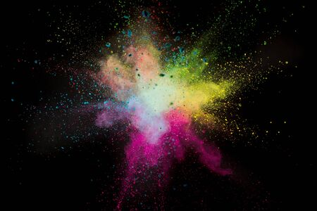 Launched colorful powder on black background Standard-Bild