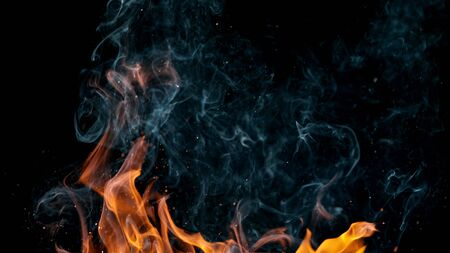 fire flames with sparks on black background Standard-Bild