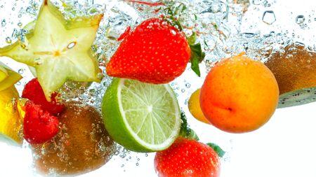Freeze Motion Shot of Fresh Fruits falling into water