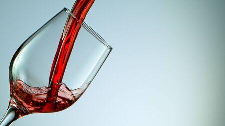 red wine pouring into wine glass Standard-Bild