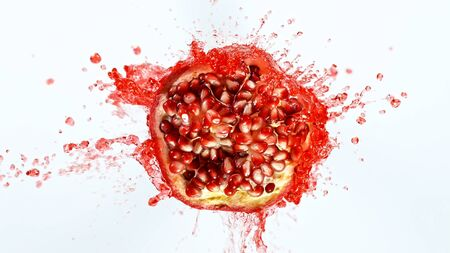 Freeze motion of sliced pomegranate with splashing juice. Imagens