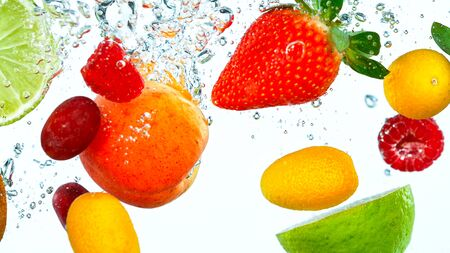 Freeze Motion Shot of Fresh Fruits falling into water