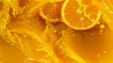 Freeze motion of pouring orange juice. Top view.