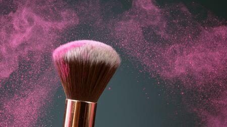 Makeup brush touch each other on dark background Zdjęcie Seryjne