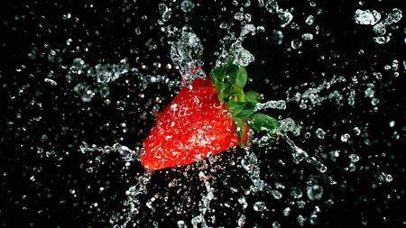 Freeze motion of fresh strawberry with splashing juice.