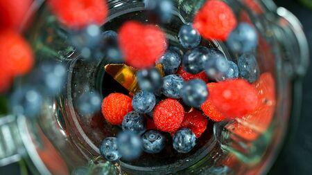 Berries fresh smoothie blended in blender, top view Zdjęcie Seryjne