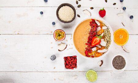 Smoothie bowl with fresh berries, nuts, seeds, fruit and vegetables. Zdjęcie Seryjne