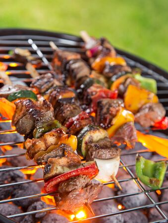 Barbecue grill with tasty skewers, close-up.