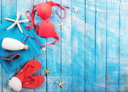 Beauty bikini and accessories on rustic wooden table.