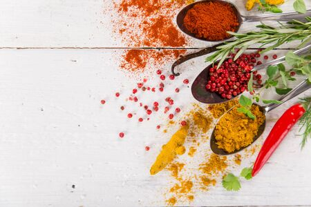 Various colorful spices on wooden table Zdjęcie Seryjne - 149855631